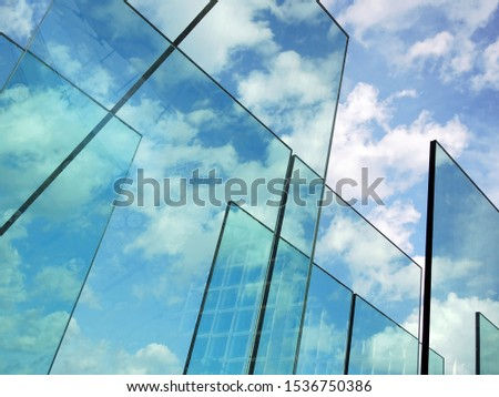Abstract background with transparent glasses through which you can see the blue sky with clouds. The concept of transparency. #1536750386