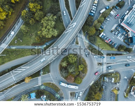 transportation, traffic in urban cityscape from above, cars driving on the road #1536753719