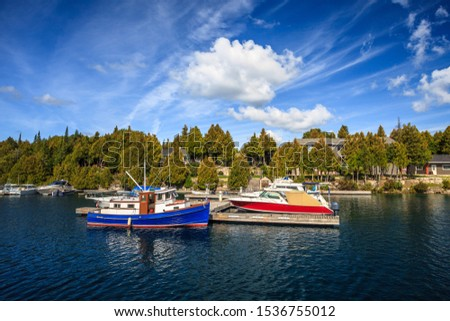 Boats Moored At The Wooden Pier In The Big Tub Harbour. Huron Lake, Ontario, Canada #1536755012