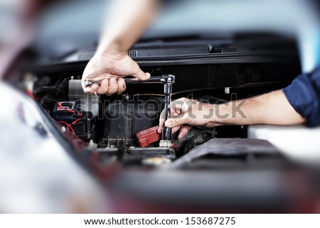 Hands of car mechanic in auto repair service. #153687275