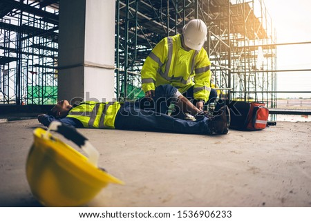 First aid support accident in site work, Builder accident fall scaffolding to the floor, Safety team help employee accident. #1536906233