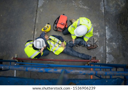 Basic first aid training for support accident in site work, Builder accident fall scaffolding to the floor, Safety team help employee accident. #1536906239