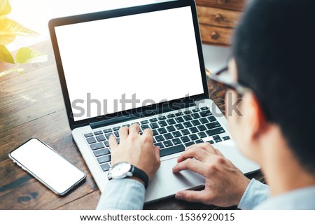 mockup image blank screen computer,cell phone with white background for advertising text,hand man using laptop texting mobile contact business search information on desk in office.marketing design  #1536920015