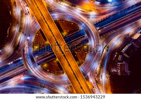 Aerial view of Smart transportation with Expressway, Road and Roundabout, busy highway traffic night time. Important infrastructure. #1536943229