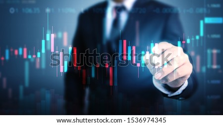 Double exposure businessman pointing line dot graph. Technical price candlestick chart graph and indicator stock online trading #1536974345