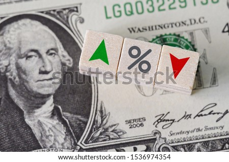 Concept idea of FED, federal reserve system is the central banking system of the united states of america and change interest rates. Percentage icon and arrow symbol on wooden cube #1536974354