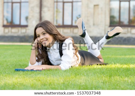 Reading is food for thought. Genius little girl lost in thought. Small cute child relax thinking thought on green grass. Learning and thinking skills. Thought or idea. #1537037348