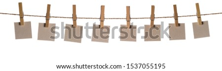 Set of eight blank paper notes held on a string with clothespins isolated on white background #1537055195