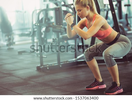 Stretch and strengthen.  Woman workout in gym. #1537063400