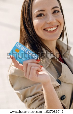 Beautiful longhaired female expressing positivity and going to shopping mall #1537089749