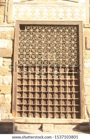 A large window of Islamic style in Al-Moez Street in Egypt #1537103801