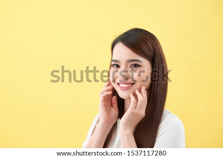 Beautiful young woman with clean fresh skin .Girl beauty face care. Facial treatment  #1537117280
