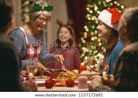 Merry Christmas! Happy family are having dinner at home. Celebration holiday and togetherness near tree. #1537172681