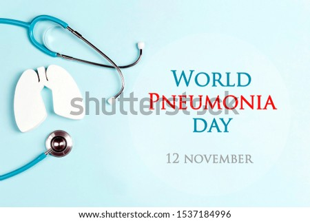 World pneumonia day concept with lungs and stethoscope on a blue background. Healthcare and medical campaign. Royalty-Free Stock Photo #1537184996