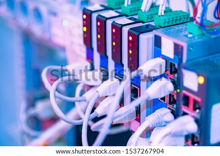 Cabling. Cables in the connectors.The source of electrical power. Wires connected to power supply. Cables in electrical connectors. Support of power supply. Electrical products. Electrical engineering #1537267904