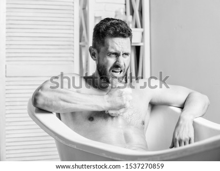 Skin care. Hygienic procedure concept. Total relaxation. Personal hygiene. Take care hygiene. Nervous system benefit bathing. Cleaning parts body. Hygiene concept. Man muscular torso sit in bathtub. #1537270859