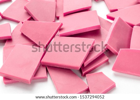 Ruby chocolate pieces, a heap on a white background #1537294052