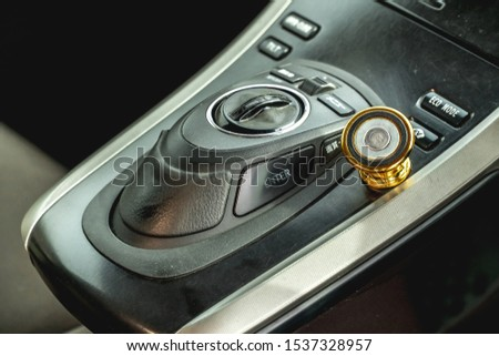 The bright photo of the dashboard in the car with black salon #1537328957