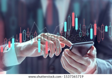 Businessman using a mobile phone to check stock market data, Technical price graph and indicator, Double exposure. #1537365719