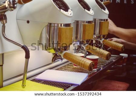 Making espresso in espresso machine  #1537392434