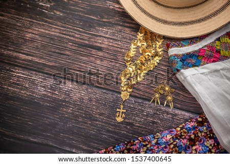 Traditional Camisole of the handmade peasant woman of Panama, with her gold jewelry and panama hat #1537400645