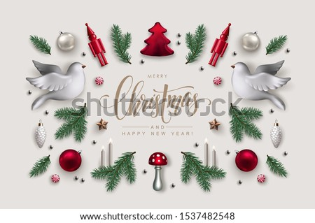 Decorative Frame made of Christmas Ornaments, Pine Branches, White Doves and Burning Candles. Flat lay, top view. #1537482548