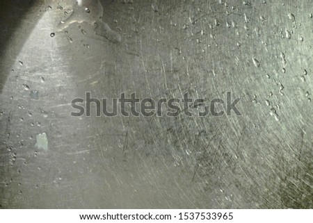 Close up of steel sink creating a variation of cloudy homogenous fields                    #1537533965