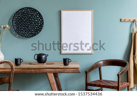 Stylish scandinavian dining room interior with mock up poster frame, wooden table, furniture, teapot with cups, black decoration and elegant accessories. Ready to use. Template.  Modern home decor.