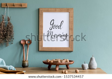 Interior design of dining room with mock up poster frame, kitchen accessories, herbs and elegant accessories. Eucaltyptus color concept. Template. Ready to use.  Stylish scandinavian home decor.