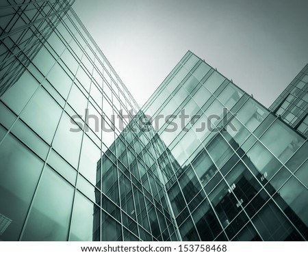 Panoramic and perspective wide angle view to steel blue background of glass high rise building skyscrapers in modern futuristic downtown at night Business concept of successful industrial architecture #153758468