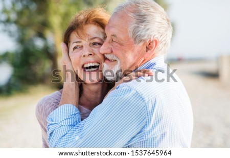 Close-up of senior couple on a holiday on a walk, hugging. #1537645964