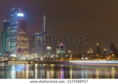 "Moscow, Russia - March 14, 2019: Photography of MIBC (Moscow International Business Center) made of glass and metal in night. Long exposure image. Translation ""Sovkom bank"" #1537688957"