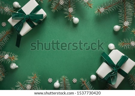 Christmas border with xmas tree and gifts on green background. Winter holiday. Happy New Year. Space for text. View from above, flat lay. Xmas. Template, mockup. Greeting card. #1537730420