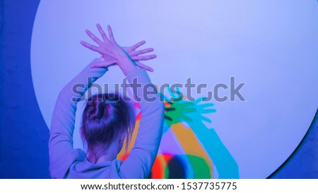 Interactive exposition in science museum. Colored shadows of dancing woman. Science, optical and physics concept #1537735775