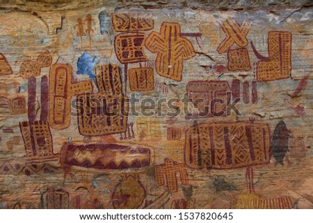 """Rock painting in the region of Peruacu River Valley (in Portuguese: """"Vale do rio Peruaçu"""" - State of Minas Gerais - Southeast Brazil. The picture is made most of enigmatic drawings."""