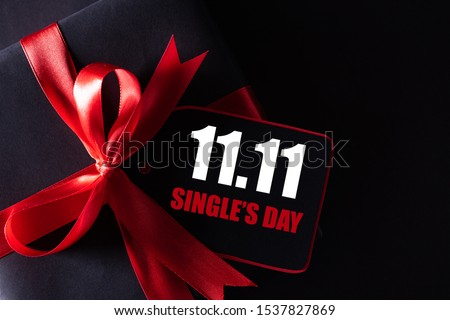 Online shopping of China, 11.11 single's day sale concept. black and red paper tag with ribbon on black background with copy space for text 11.11 single's day sale. #1537827869