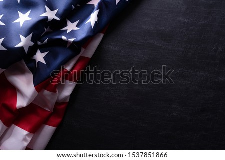 Happy Veterans Day. American flags veterans against a blackboard background. #1537851866