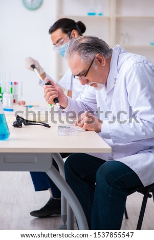 Two chemists working in the lab #1537855547