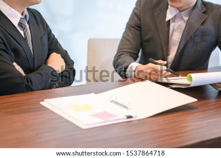 Close up of Businessmen discuss information or brainstorm metting in a business working space. #1537864718