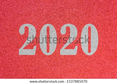 texture of running racetrack red rubber racetracks with 2020 Happy New Year text,During Christmas and New Year. #1537885070