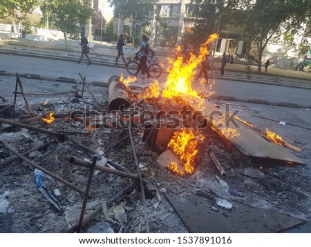 Santiago, Chile; Oct 20, 2019: Fire barricade on Chile's social protests #1537891016