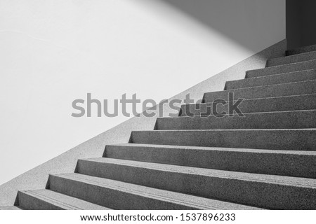 Architectural design of stair concrete with shadow looking at a mirage Black and white. Copy space Royalty-Free Stock Photo #1537896233