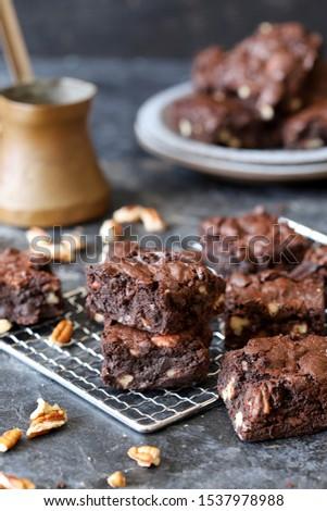 Homemade fudgy chocolate brownies on grey background. chocolate walnut brownie cake still life #1537978988