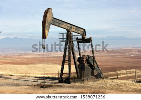 View of Oil Well Pumpjack (Horsehead) at Daylight Oil Industry