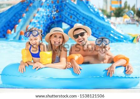 Happy family resting in aqua park #1538121506