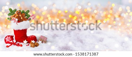 Saint Nicholas  -  Santa Boot filled with gifts -   Bokeh Winter Background  -  Christmas Banner -  Snow landscape panorama #1538171387