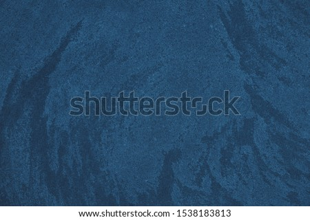 Elegant navy blue colored dark Concrete textured background with roughness and irregularities to your design or product. Color trend concept.