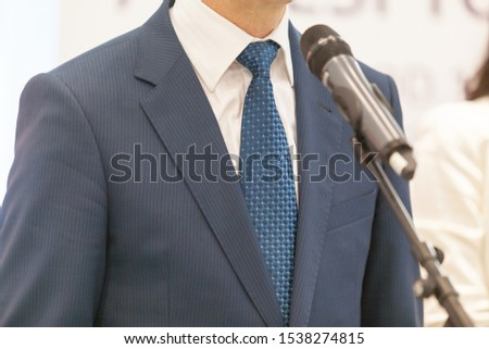 Business person or politician is giving a speech at media event #1538274815
