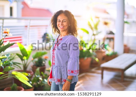 Middle age beautiful woman smiling happy and confident standing with a smile on face at terrace #1538291129