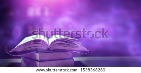 Imagine a picture book of an ancient book opened on a wooden table with a sparkling golden background. With magical power, magic, lightning around a glowing glowing book In the room of darkness #1538368280